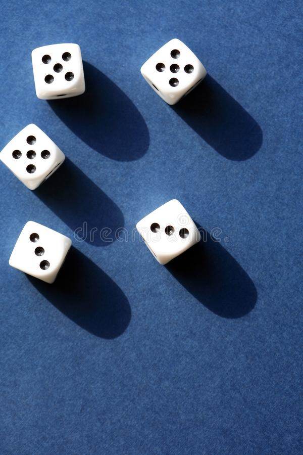 Dice Game On Blue. Few dice cubes on blue background with free space stock images