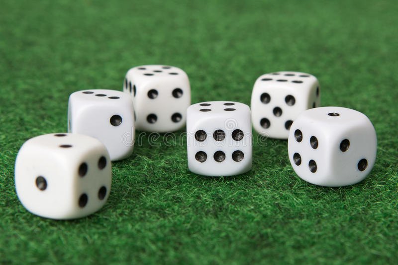 Dice on green mat royalty free stock photo