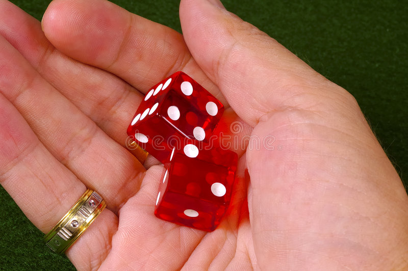 Dice in Hand royalty free stock images