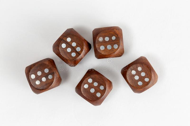 Dice made of wood showing six`s stock photography