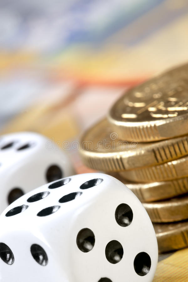 Dice and Money. Dice with stack of gold coins. These are Australian dollars royalty free stock image