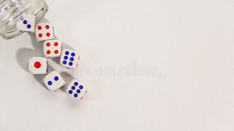Dice and glass jar on white background royalty free stock photos