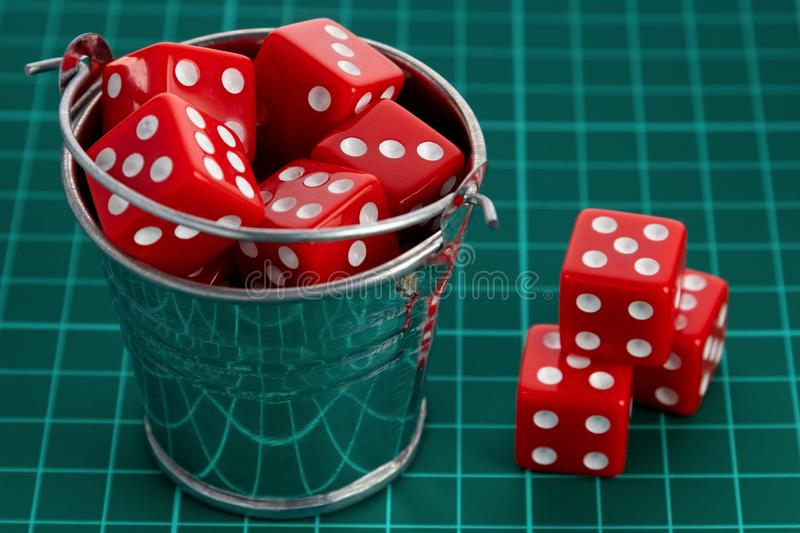 Dice red in a metal bucket. Concept of random numbers royalty free stock photo
