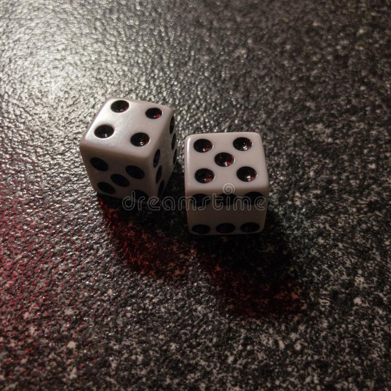 Two dice roll nine stock image