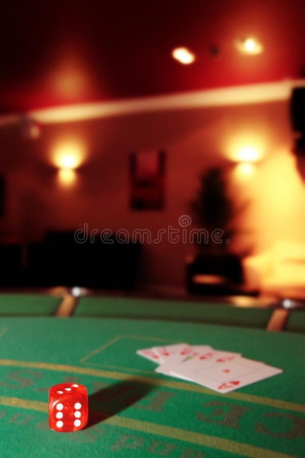 Dice with royal flush of hearts. Green casino table with dice and a hand of a royal flush in a poker game royalty free stock images