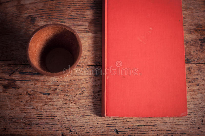 Dice shaker and book royalty free stock photography