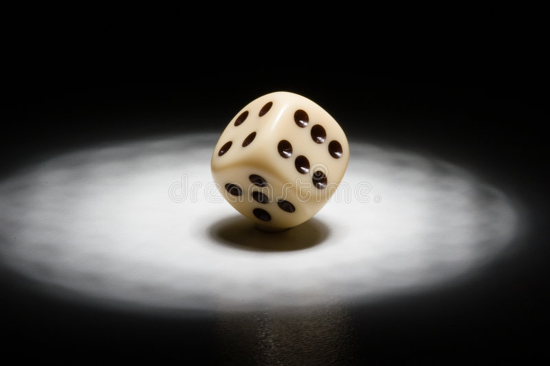Dice in the spotlight royalty free stock photography