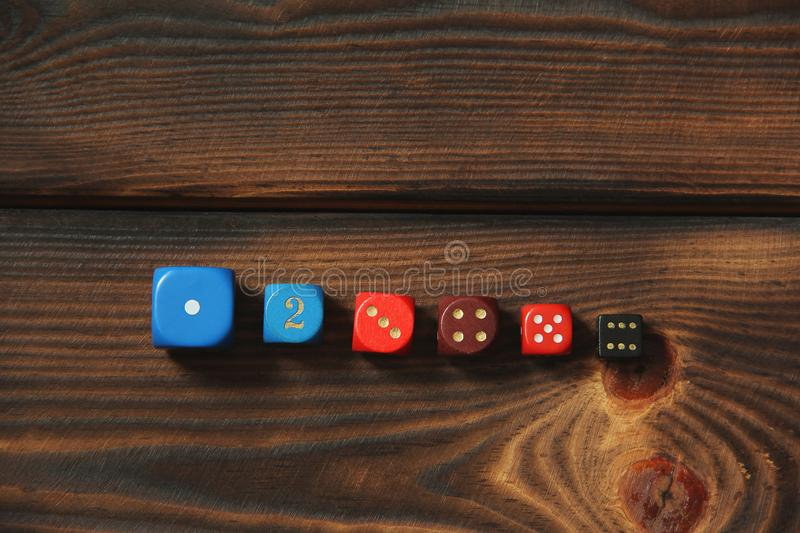 Dice on a wooden background royalty free stock photos