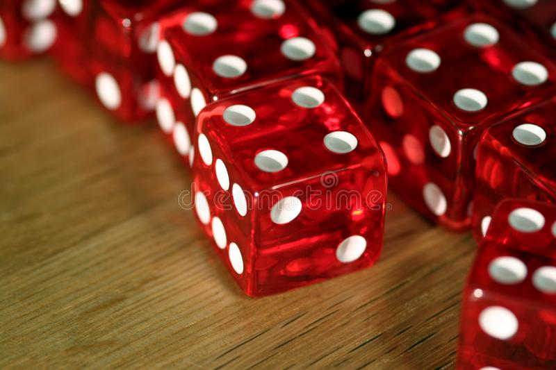 Dice on wooden table (macro) stock image