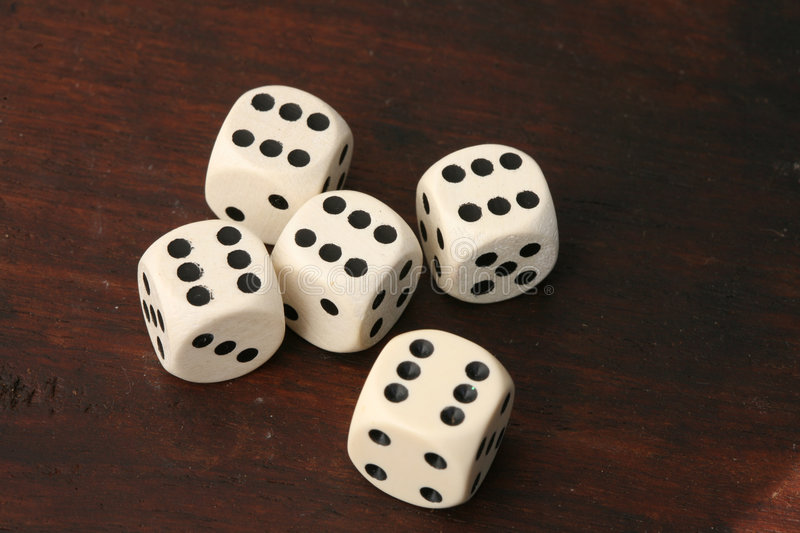 Dices. Playing with several white dices on various backgrounds stock image