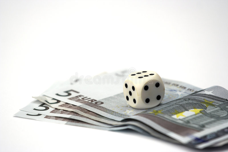 Dices and bills. Dices over euro bills close up royalty free stock photo