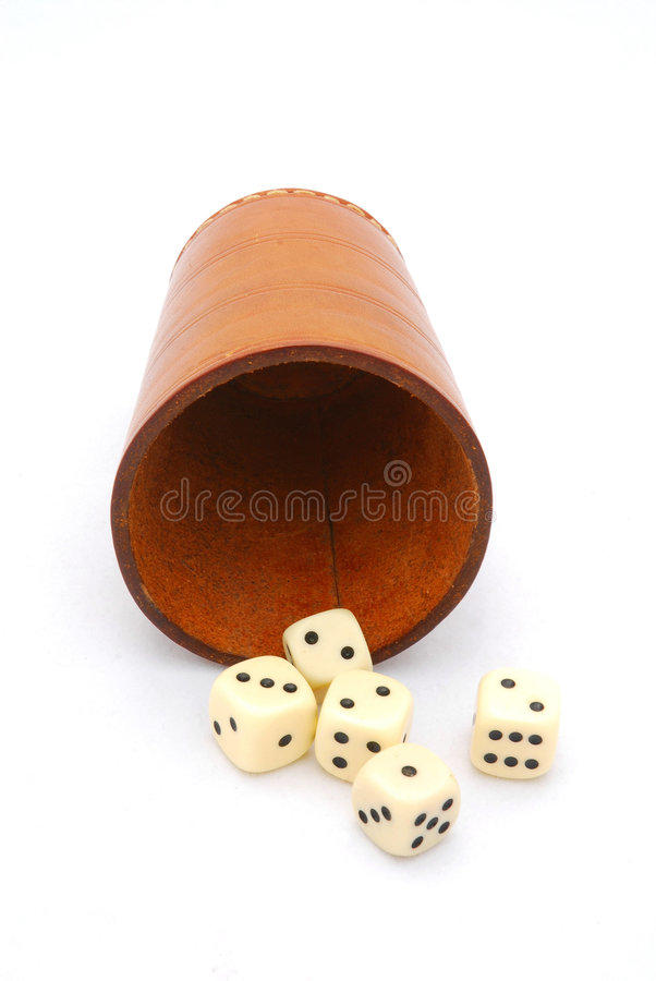 Dices with dice cup. Front view of an old used brown leather dice cup with five dices. Image isolated on white studio background royalty free stock image