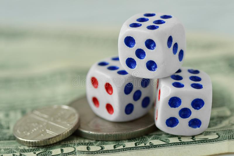 Dices on dollar money background - Concept of risky investments and gamble. Dices on dollar money background. Concept of risky investments and gamble royalty free stock photo