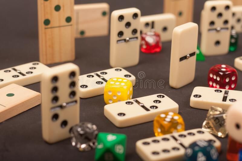 Dices and dominoes  game on a black background. Children numbers school mathematics stock photo