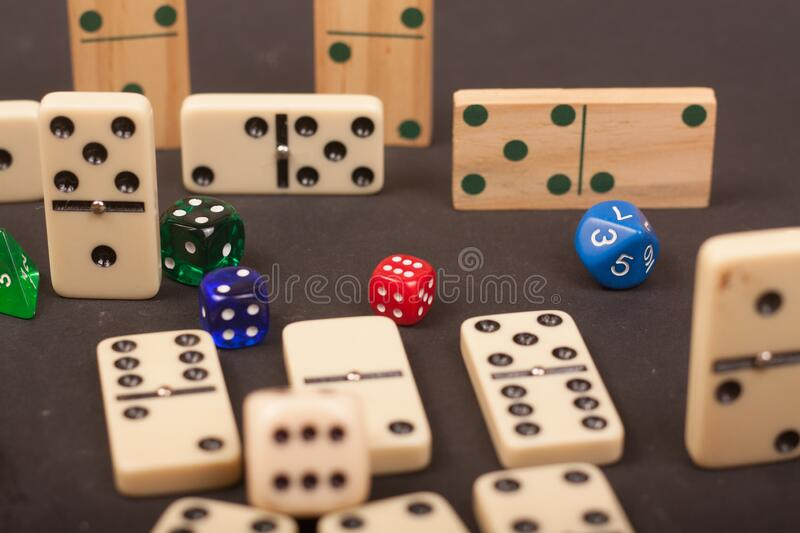 Dices and dominoes  game on a black background. Children numbers school mathematics royalty free stock photo