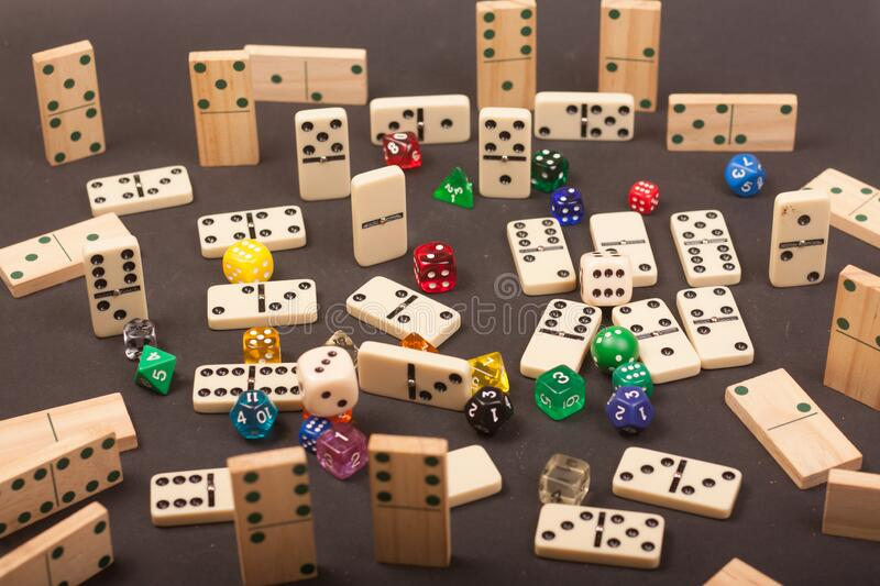 Dices and dominoes  game on a black background. Children numbers school mathematics royalty free stock images