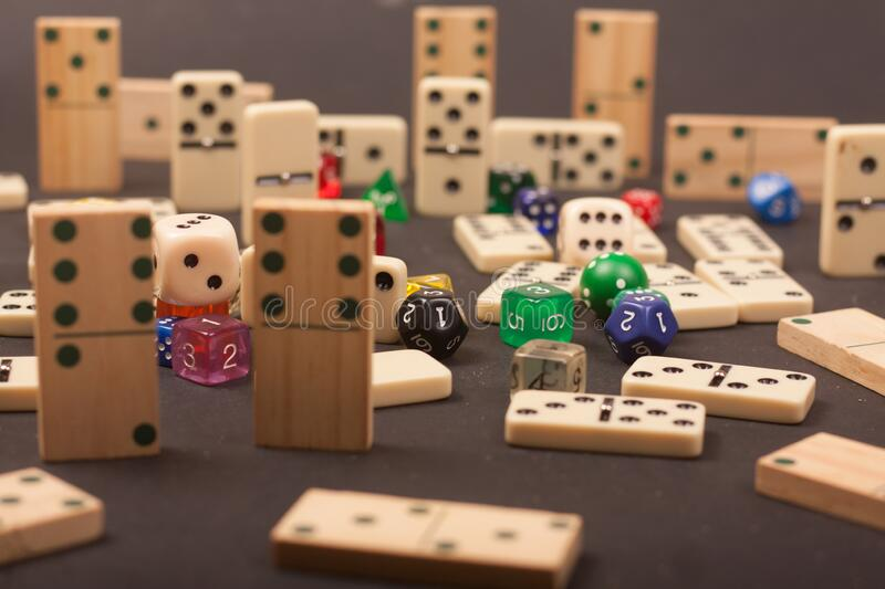 Dices and dominoes  game on a black background. Children numbers school mathematics royalty free stock image