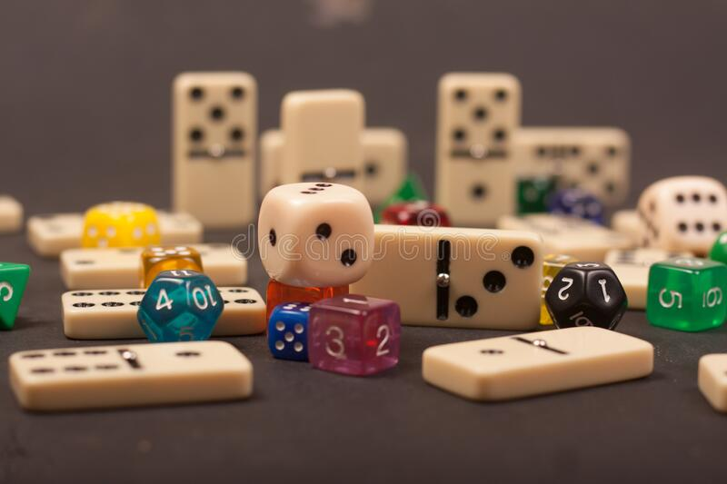 Dices and dominoes  game on a black background. Children numbers school mathematics stock photos