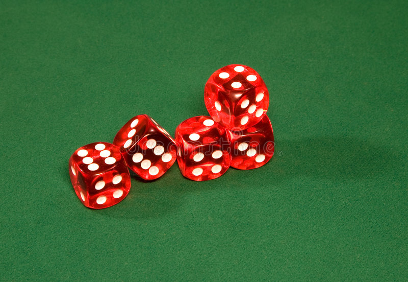 Dices in Vegas. Red dices on the green table in the casino stock images