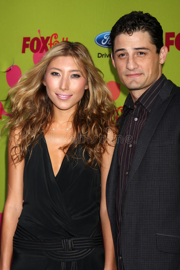 Dichen Lachman. & Enver Gjokaj arriving at the FOX-Fall Eco-Casino Party at BOA Steakhouse in West Los Angeles, CA on September 14, 2009 royalty free stock photography