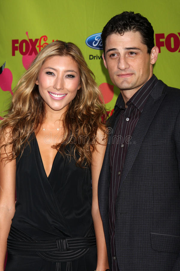 Dichen Lachman. & Enver Gjokaj arriving at the FOX-Fall Eco-Casino Party at BOA Steakhouse in West Los Angeles, CA on September 14, 2009 royalty free stock image