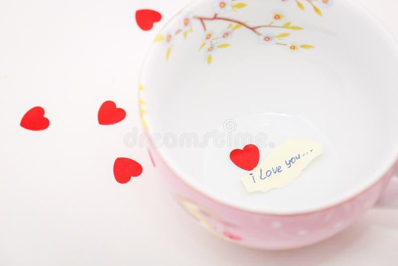 Dichiarazione di amore in una tazza fotografia stock