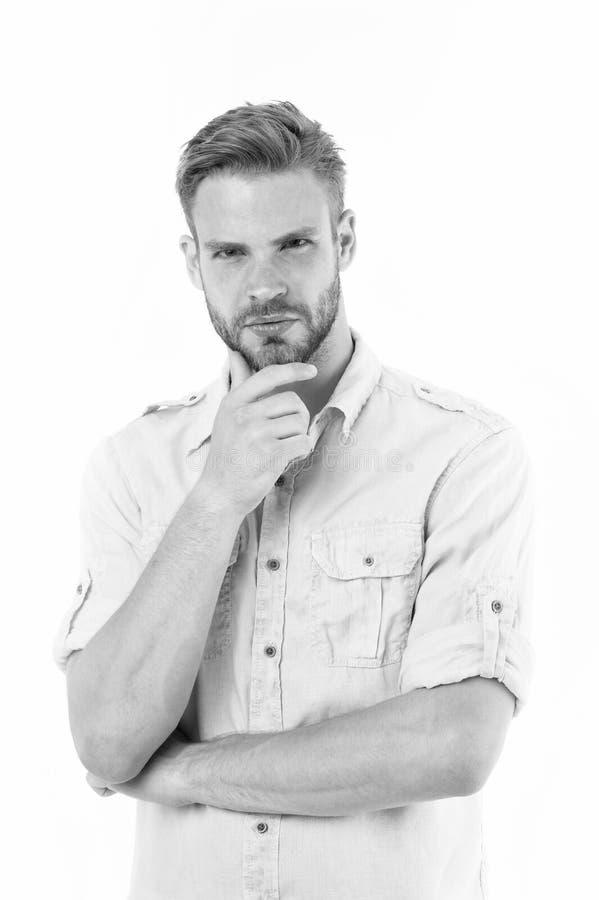 Dicht bij oplossing Mens die met varkenshaar ernstig gezicht witte achtergrond denken Kerel nadenkende aanrakingen zijn kin Naden stock foto