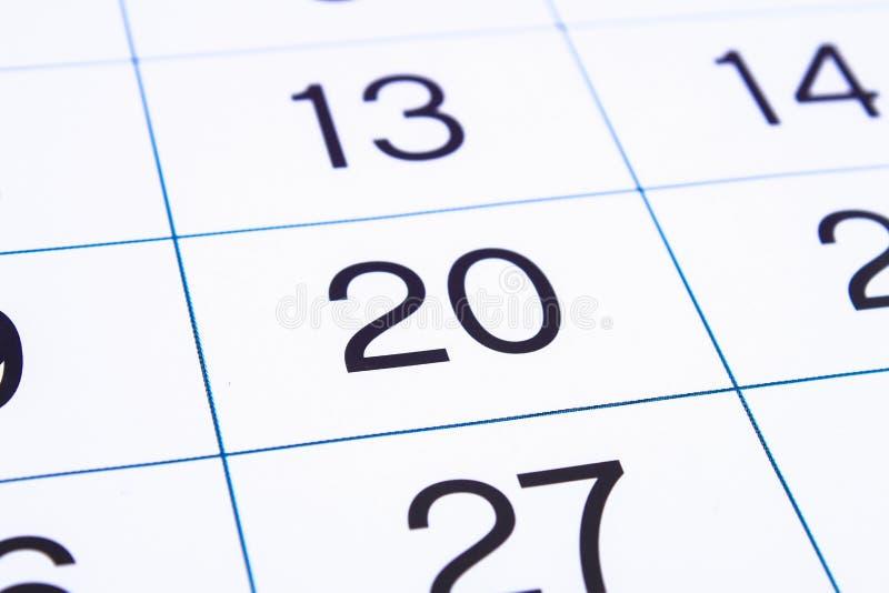 Dichte omhooggaand van de kalenderpagina Grote aantallen De achtergrond van de kalenderpagina Nummer 20 stock afbeelding