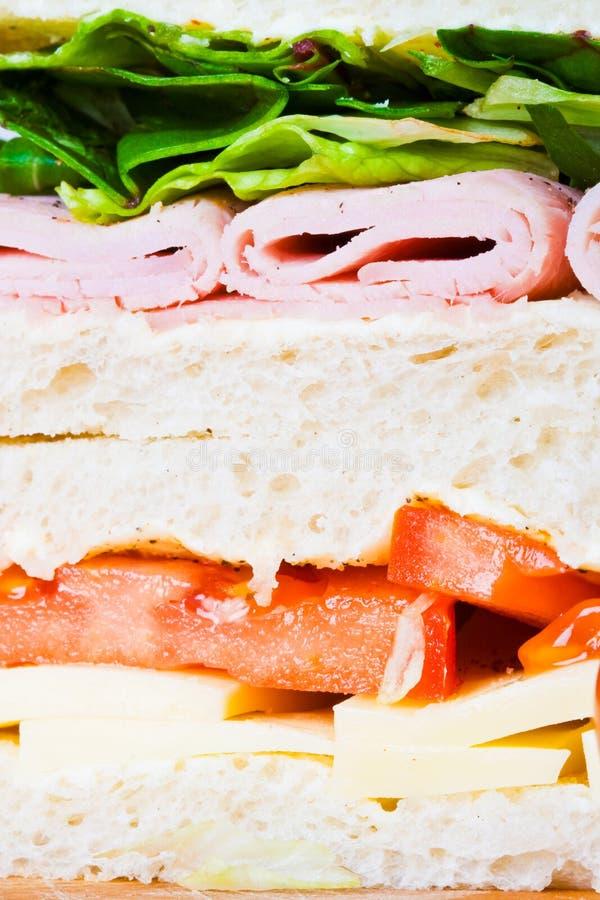 Dichte omhooggaand van de sandwich stock afbeelding