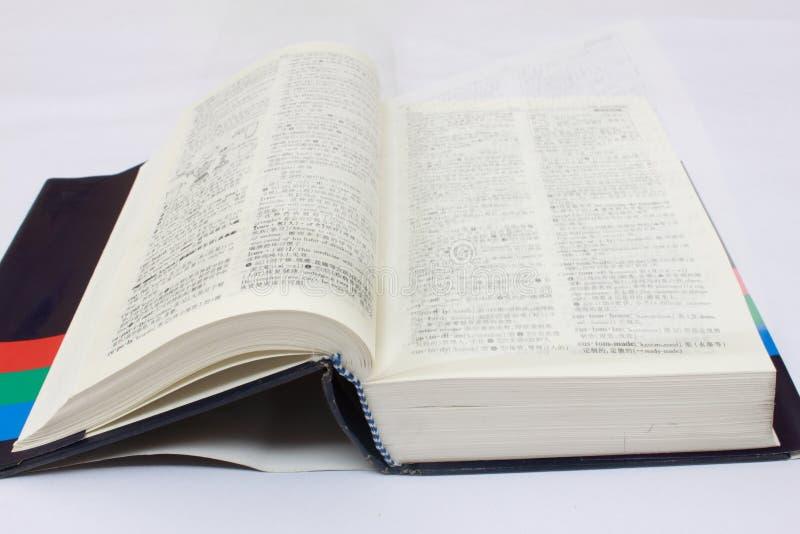 Dicionário na mesa fotografia de stock