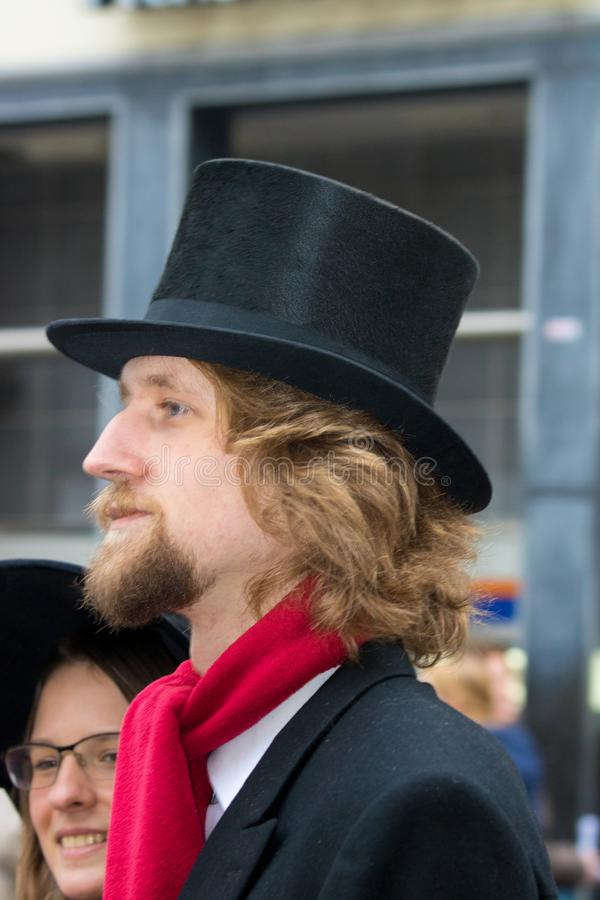 Free Dickens Festival Christmas Carol Man With Red Scarf And Old Hat Stock Photo - 106911390
