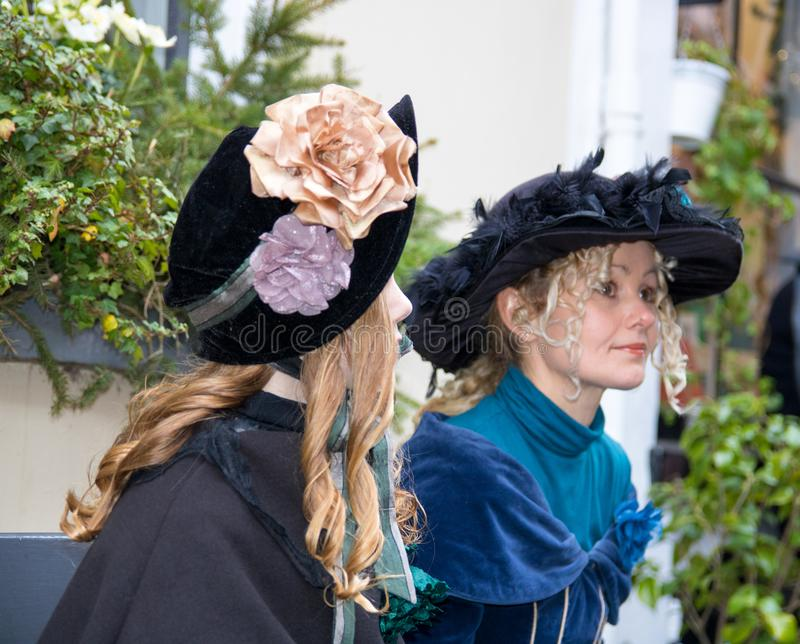 Dickens festival women with bleu hats Christmas carol. Dickens festival characters Christmas carol every year in Deventer, with different characters. men and royalty free stock photo