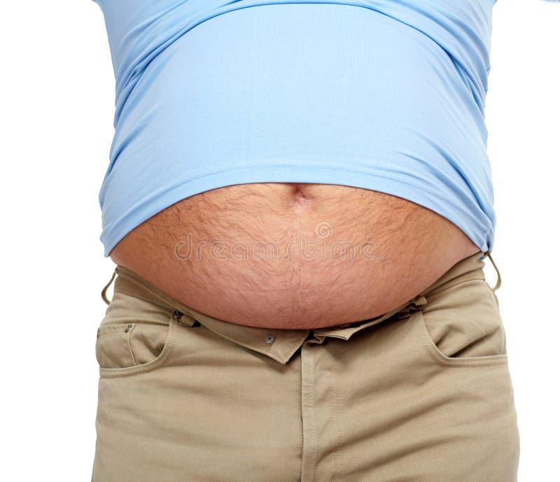 Dicker Mann mit einem dicken Bauch. lizenzfreie stockbilder