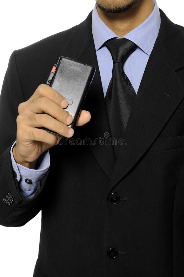 Dictáfono del asimiento del hombre de negocios imagen de archivo
