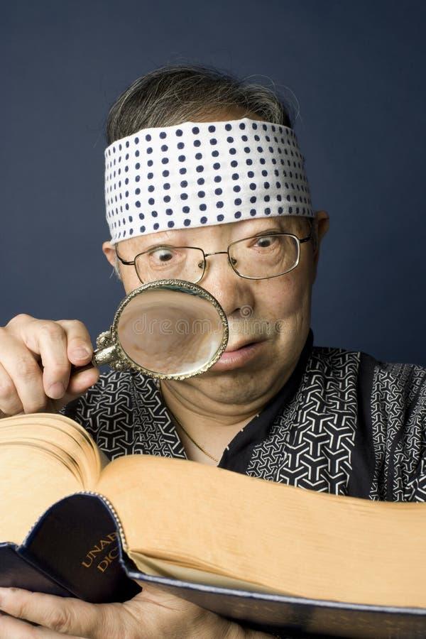 dictionary examines japanese man senior στοκ φωτογραφίες
