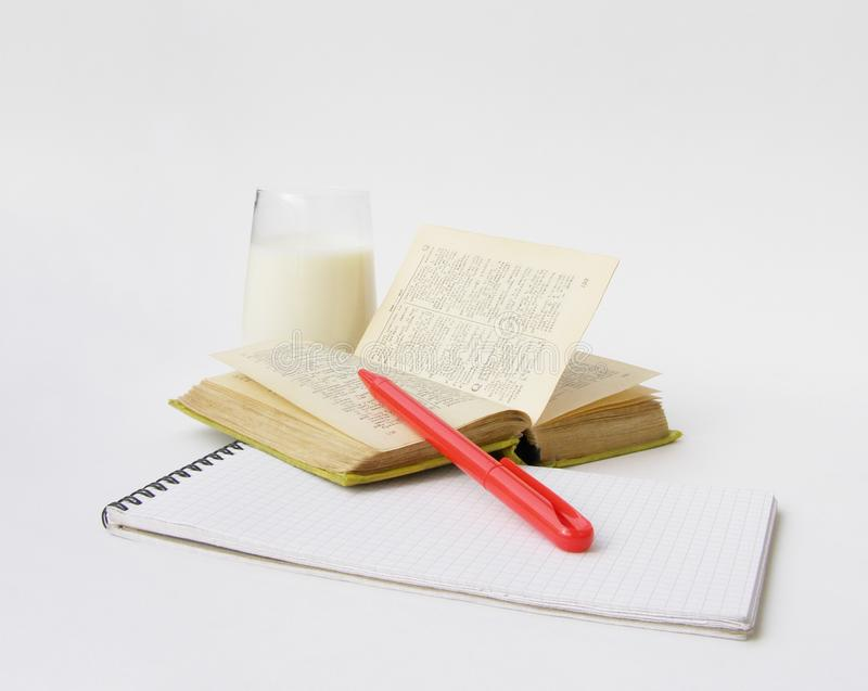 Dictionary and milk stock photography