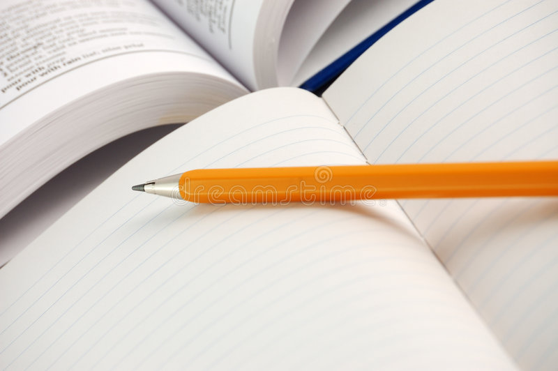 Dictionary with notebook. And pencil royalty free stock photography