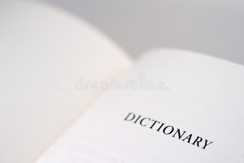 Dictionary. An open book with the word dictionary reading on the right page, copy space available royalty free stock photo