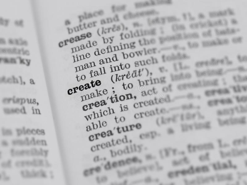 Dictionary page featuring definition of the word create with selective focus applied stock photo