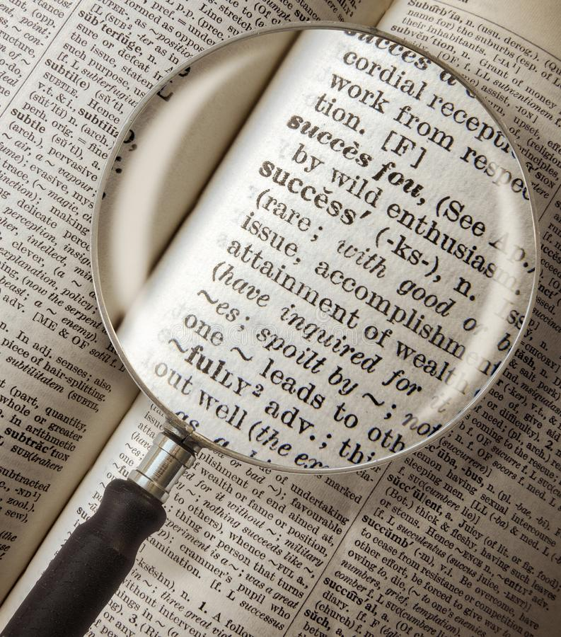 Dictionary Success Magnified. Magnifying Glass Focused On The Word Success In A Vintage Dictionary royalty free stock photo