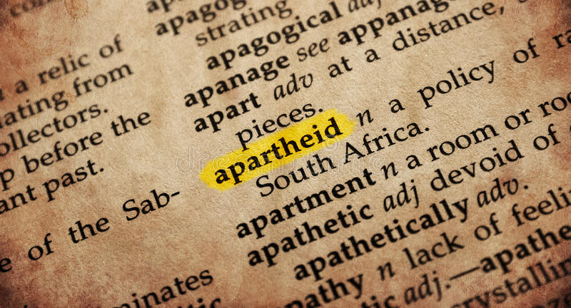 Dictionary word. Apartheid word in old textured dictionary stock photos