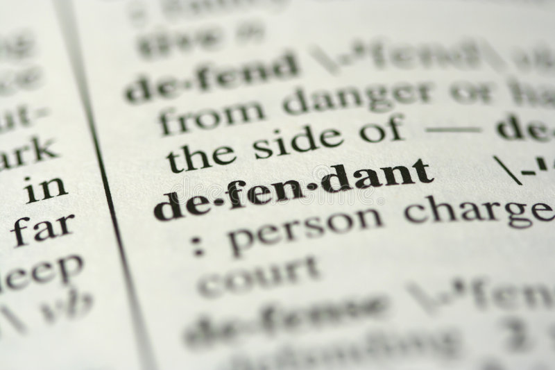 Dictionary Word - Defendant stock photos