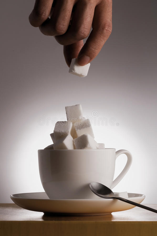Health care concept - eating too much sugar stock photo