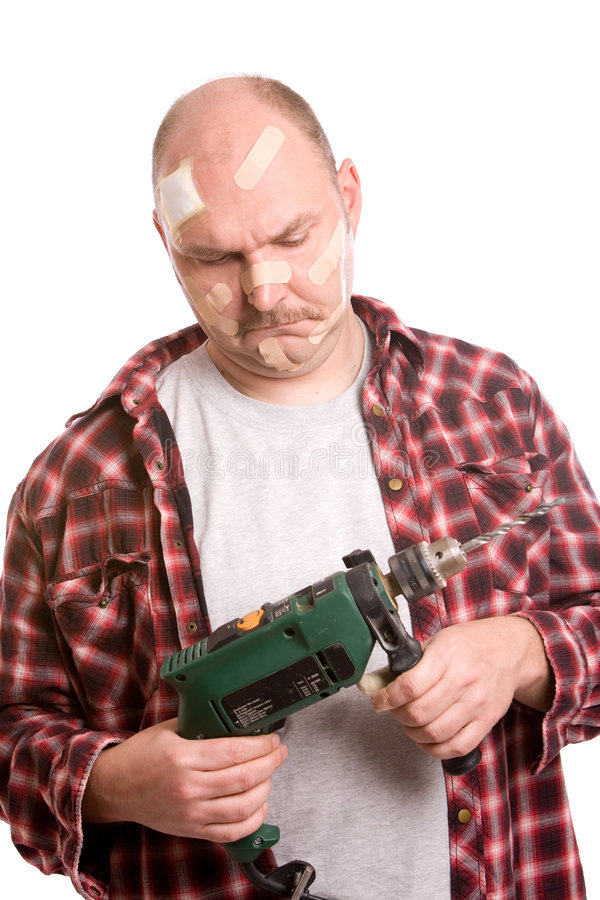 Didn't they leave a manual?. Mature man looking at the drill machine in his hand with a questioning look stock photography