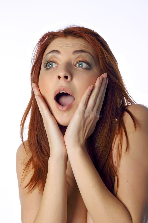 Die überraschte junge Frau lizenzfreies stockfoto