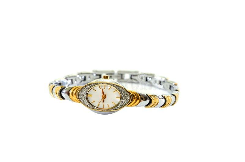 Die Armbanduhr der Damen mit Armband auf einem wei?en Hintergrund lizenzfreie stockbilder