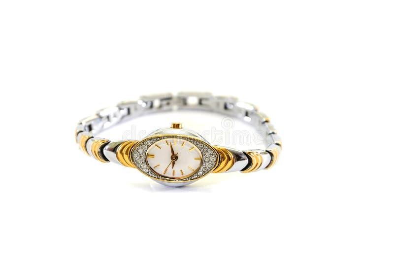 Die Armbanduhr der Damen mit Armband auf einem wei?en Hintergrund lizenzfreies stockbild