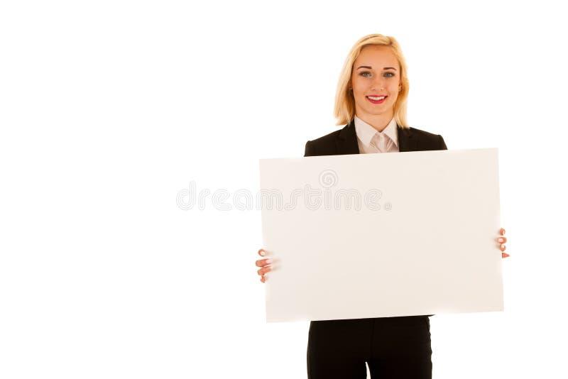 Die attraktive Geschäftsfrau, die leere weiße Fahne hilding ist, lokalisierte ov lizenzfreies stockbild