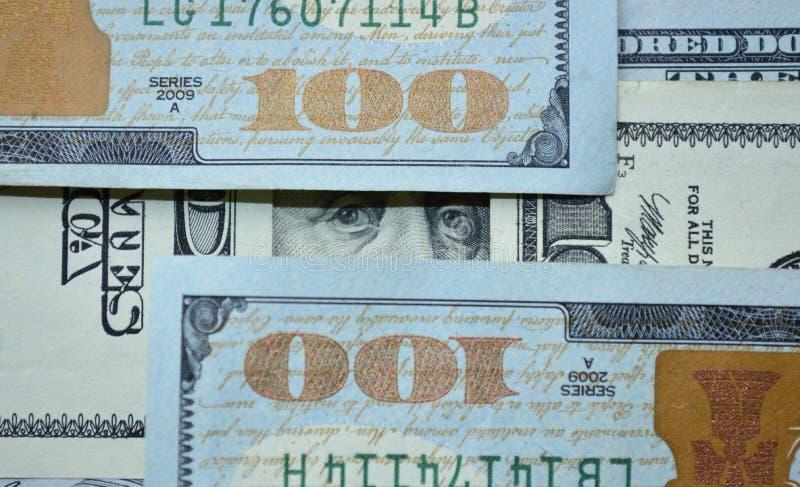 Die Augen von Benjamin Franklin auf Dollar lizenzfreie stockfotos