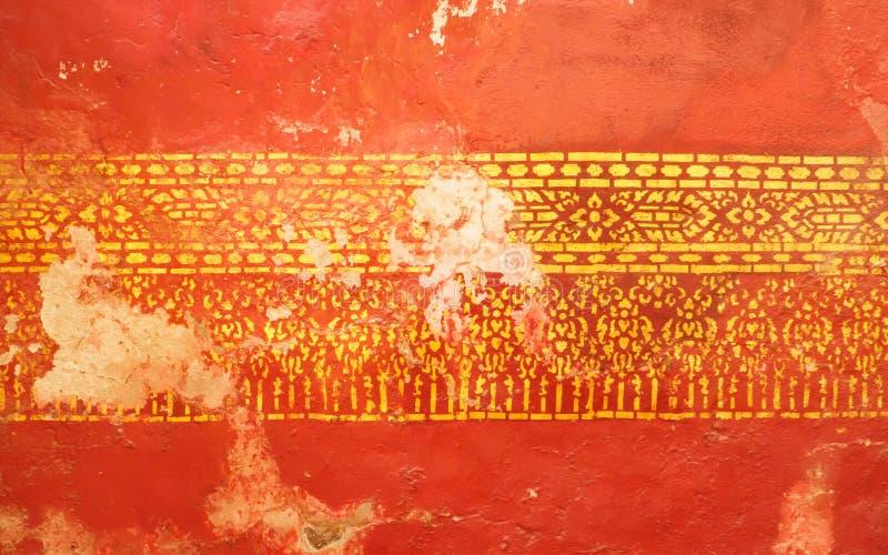 Die Ausgangsmaske war zerstört oder in einigen Teilen auf den Wänden des alten buddhistischen Tempels defekt lizenzfreie stockfotografie